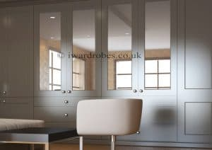 elegant made to measure spray painted closet with mirror doors and drawers