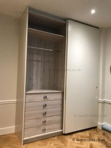 Elegant fitted wardrobe with spray-painted matt sliding doors