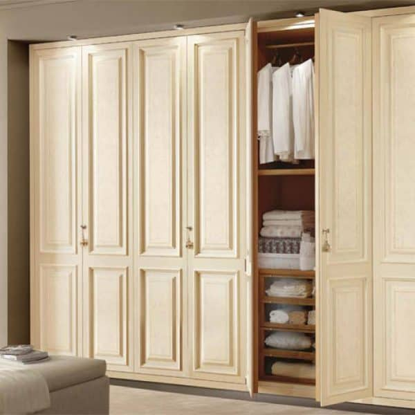 Fitted spray-painted traditional closet in London
