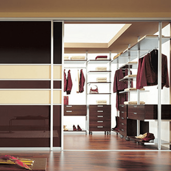 Luxury high-quality bespoke bedroom or reception room Walk in Wardrobe and storage solution with sliding doors