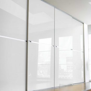 Luxurious high ceiling modern fitted White Gloss Sliding door closets