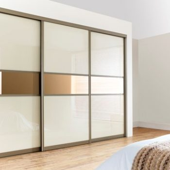 Modern made to measure ivory glass and bronze mirror strip doors in champagne frame bedroom closet