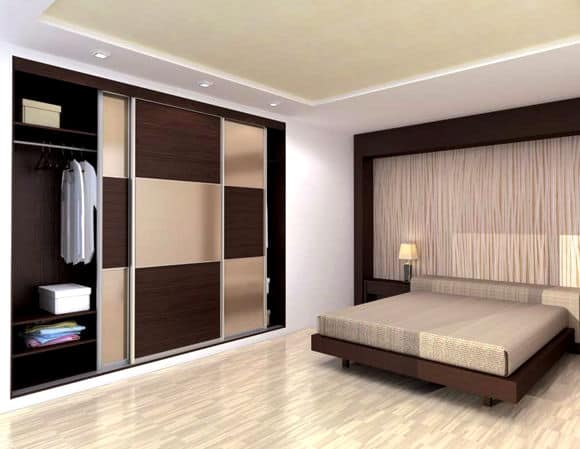 Contemporary coloured glass built-in sliding door bedroom wardrobes