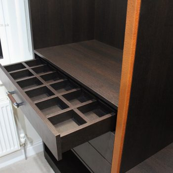 Bespoke modern wardrobe with fitted accessory storage