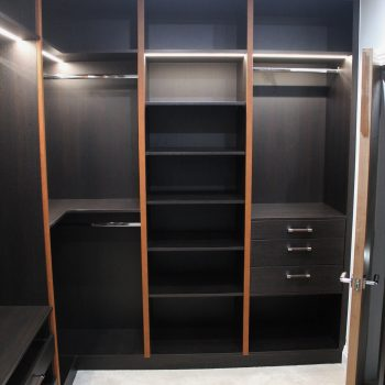 Modern l shaped fitted walk in closet in London