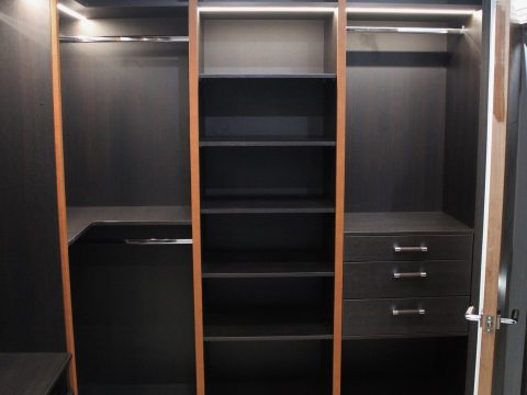 Modern l shaped fitted walk in closet in London