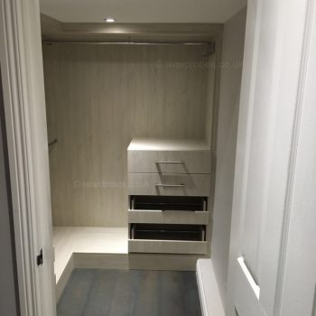 Small walk in wardrobe in London