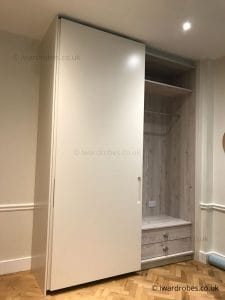 Made-to-measure fitted sliding door wardrobe with drawers, hanging space and matt doors