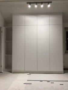 Bespoke fitted wardrobe with white matt hinged doors