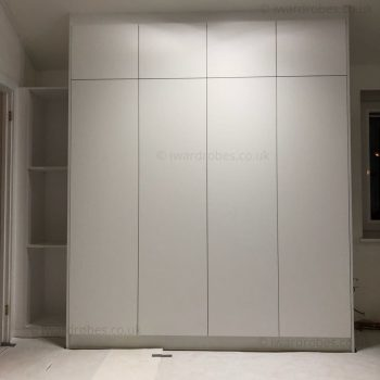 Bespoke fitted wardrobe with white matt hinged doors