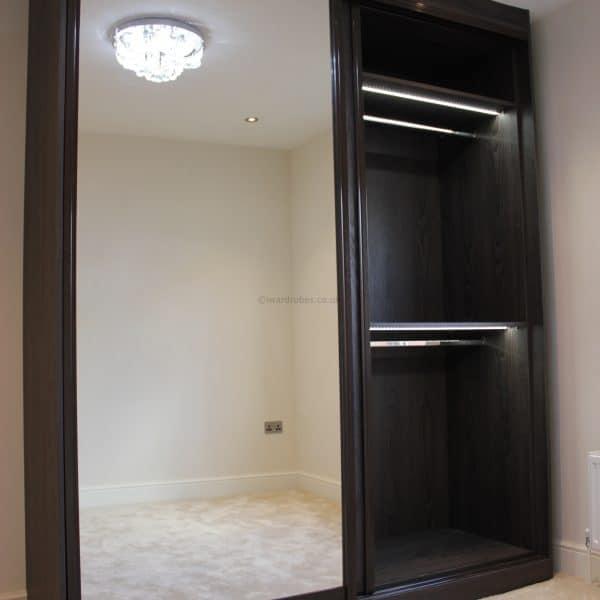 Dark fitted sliding door mirror closet