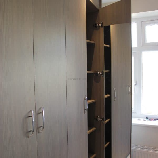 Built in modern hinged door wardrobe in london