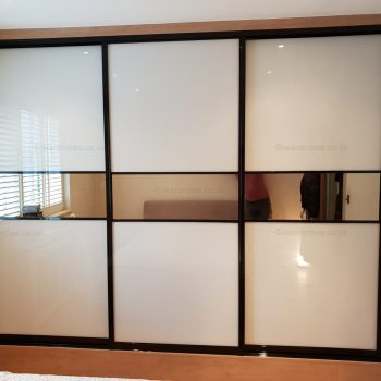 Fitted mirror sliding door wardrobe