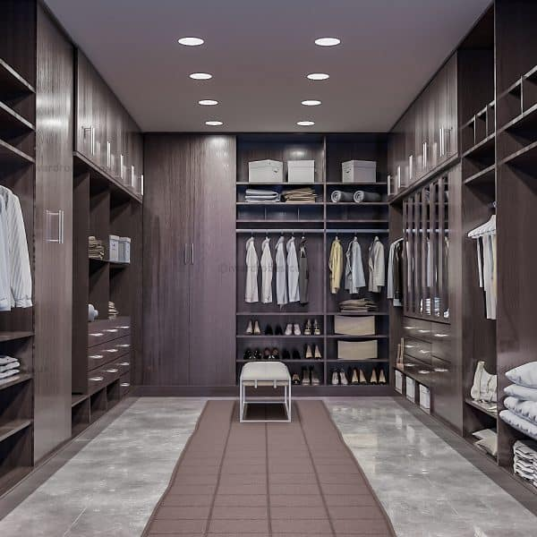Dark fitted walk in wardrobe