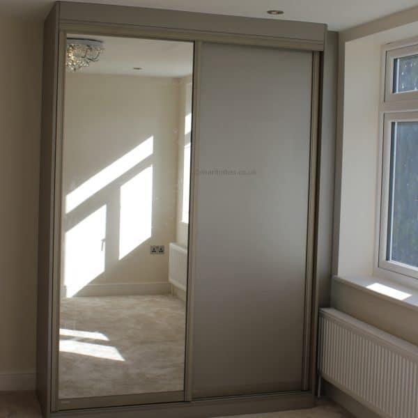 Bespoke built in mirror sliding door wardrobe
