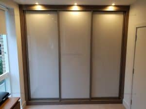 Custom made built in modern sliding door wardrobe in London
