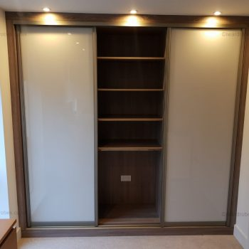 Built-in glass sliding door wardrobe in London