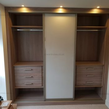 Built in lacquered glass sliding door wardrobe in London