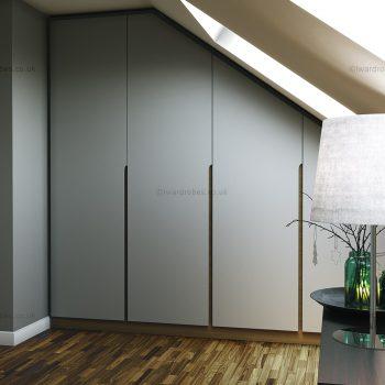 bespoke loft fitted spray painted higed door wardrobe in London