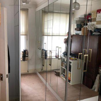Fitted mirror hinged door wardrobe