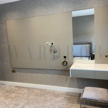 Bespoke quest bedroom decorative panel with mirror and dress-up table in London