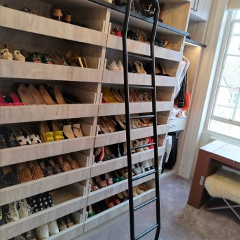 bespoke dressing room with high ceilings and sliding stairs in London