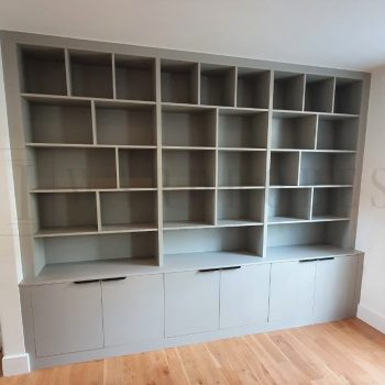 Bespoke reception fitted book case with hinged door sections in London