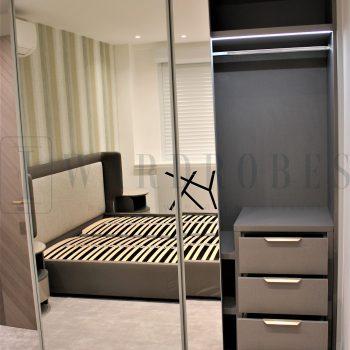 Bespoke modern mirror sliding door wardrobe in London