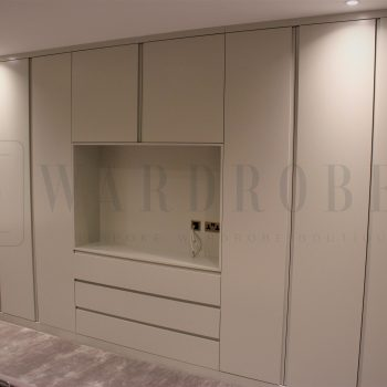 Made to measure white spray painted closet with J handles in London